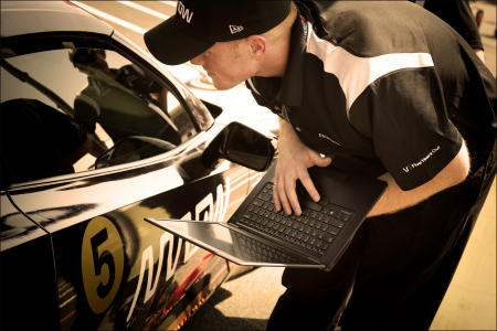 An Arrow engineer runs a series of tests before Sam begins the climb at Pikes Peak, Colorado.