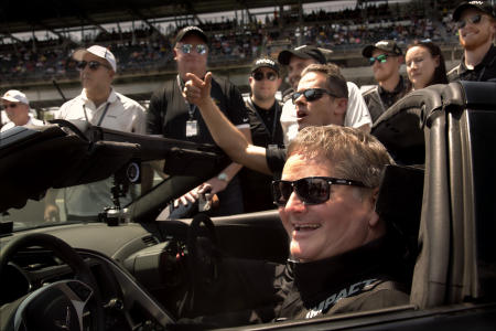 Arrow staff surrounds Sam Schmidt at the Indianapolis Motor Speedway, where he reached a new top speed of 152 mph.