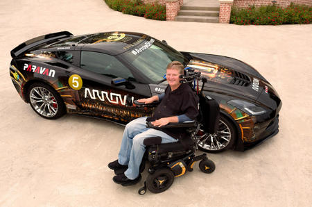 Sam Schmidt sits in front of his customized Arrow racecar. Before the start of the 2000 Indy Car Series while practicing in Orlando, Florida, Schmidt crashed and was rendered a quadriplegic.