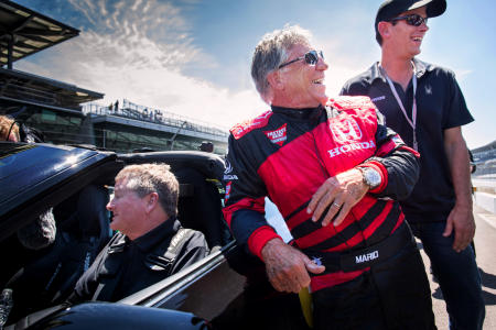 Mario Andretti has a laugh with Sam after the pair staged an exhibition race where they both drove semi-autonomous (SAM) cars in May of 2017.