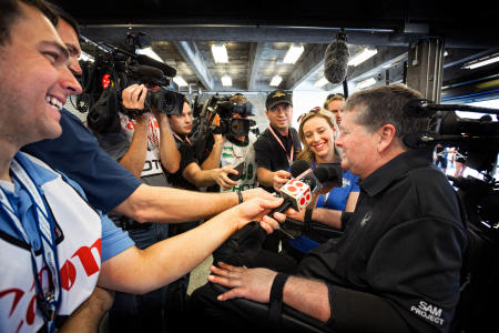 Sam talks to the media immediately after his SAM car race at the Indianapolis Raceway with Andretti, the 77-year-old racing legend.