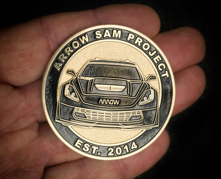 Arrow Electronics created this 2.25-inch challenge coin to hand out at events. The message on the backside: Be the driver of your life.
