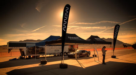 Sam and the team from Arrow traveled to Nellis Air Force Base in Las Vegas, Nevada, to be part of its air show celebrating Veterans Day. As the sun comes up over the mountains, Grace Doepker, an Arrow engineer, prepares for the hundreds of visitors who will stop by the Arrow Booth to learn about the SAM car.